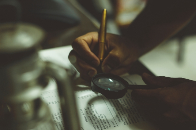 pen-and-magnifying-glass