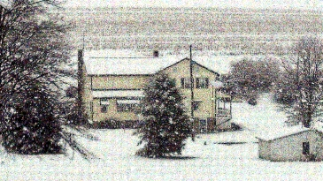 Snow Falling On Farm House