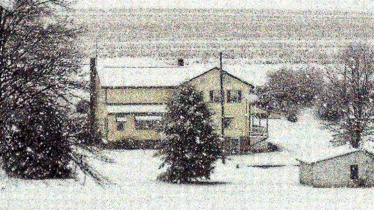 Snow Falling On Farm House